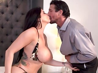 Romi is a smashing brunette with big milk jugs who likes to ride a stiff cock